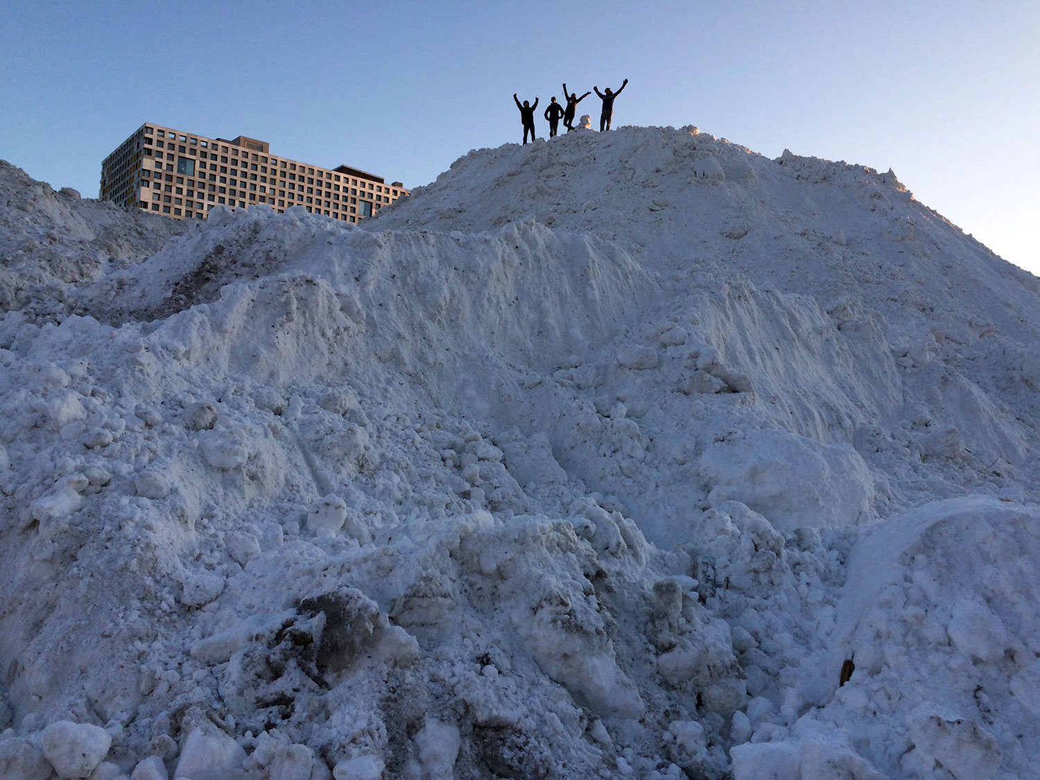 "Students cheep atop a large snow mound dubbed the ""Alps of MIT"" (Credit: Tom Gearty/MIT)."