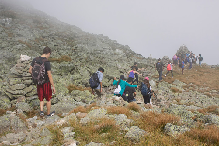 Students walk through a cloud as they navigate Mount Washington's rocky terrain. Credit: Min Ding