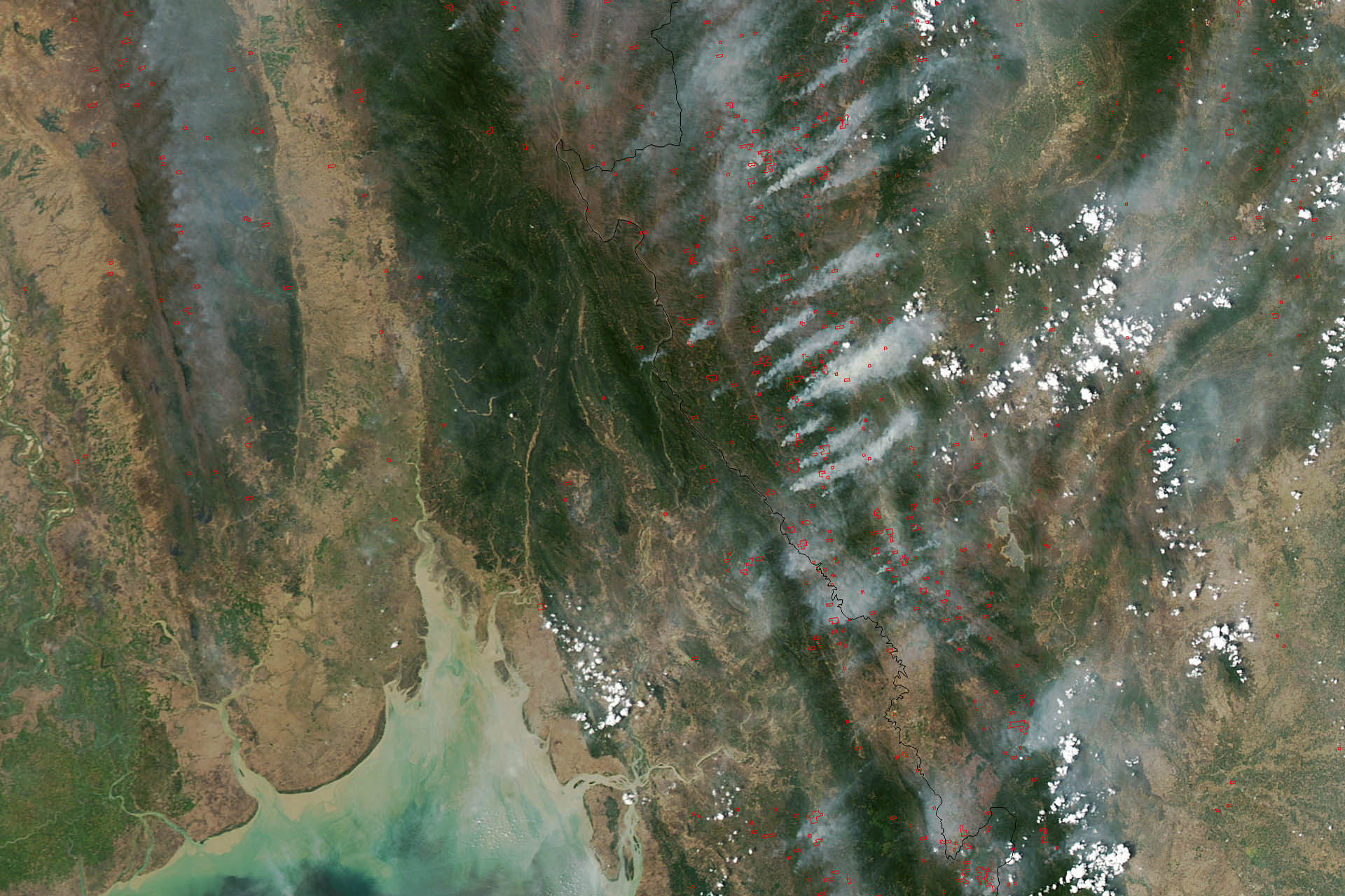 This image of fires burning throughout Burma (Myanmar) and Thailand was acquired on March 22, 2013, by the Moderate Resolution Imaging Spectroradiometer (MODIS) on NASA's Aqua satellite. MODIS detects fires not from visible smoke plumes, but from thermal infrared energy radiating from the land surface. The heat is invisible in images like this, but the locations where MODIS detected fires are labeled with red dots. (Source: NASA)